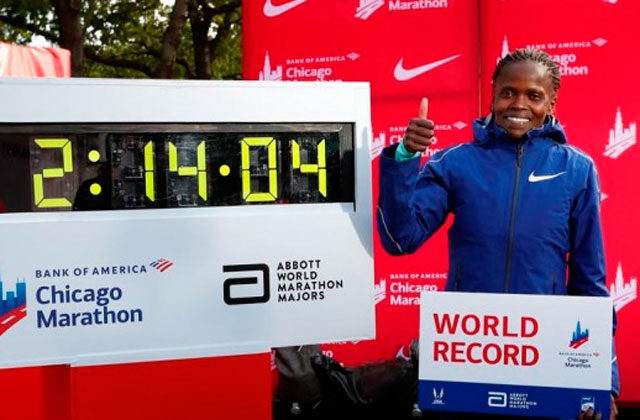 Kosgei poses with the world record